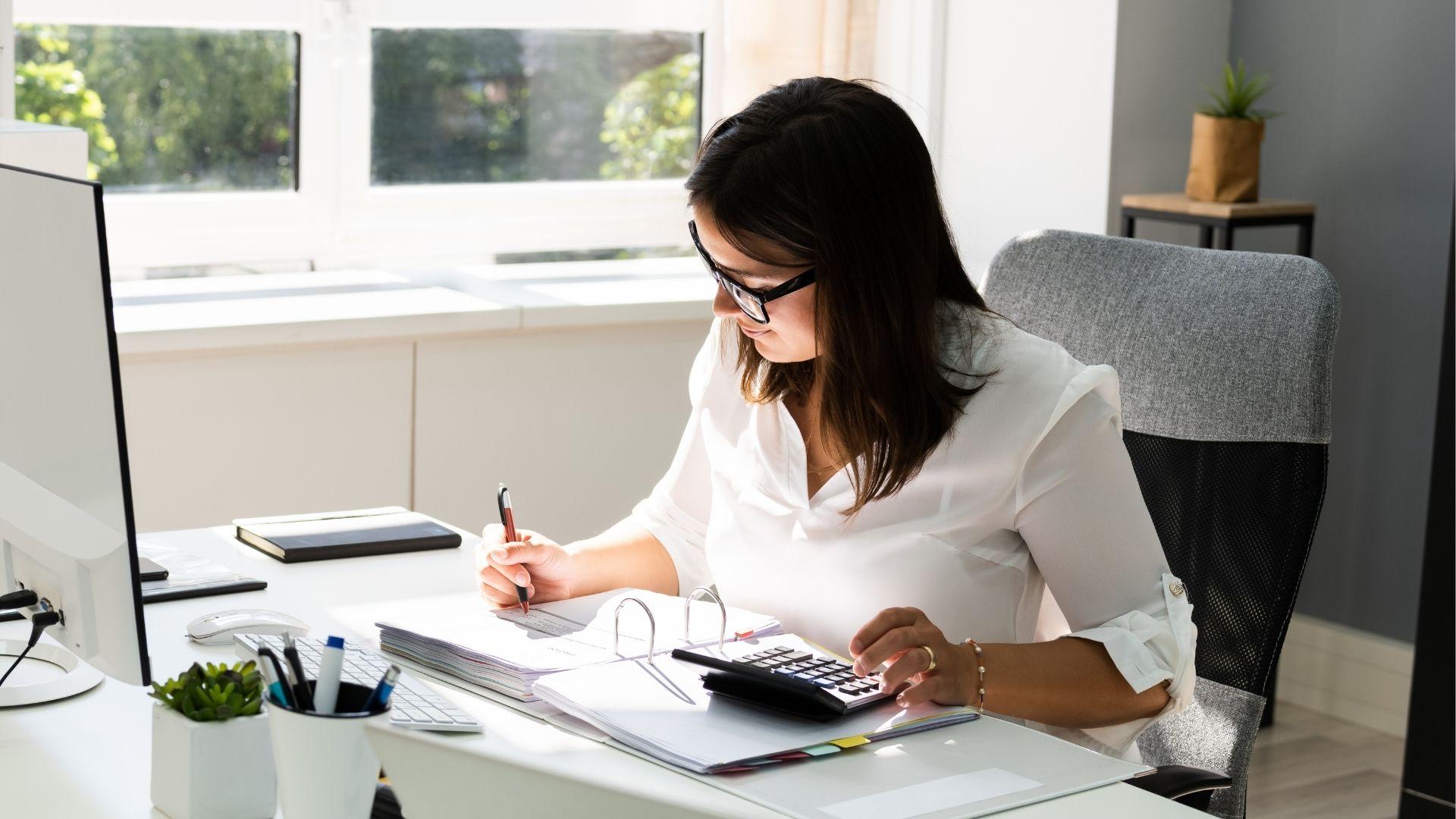 accounts clerk desk calculator pen folder